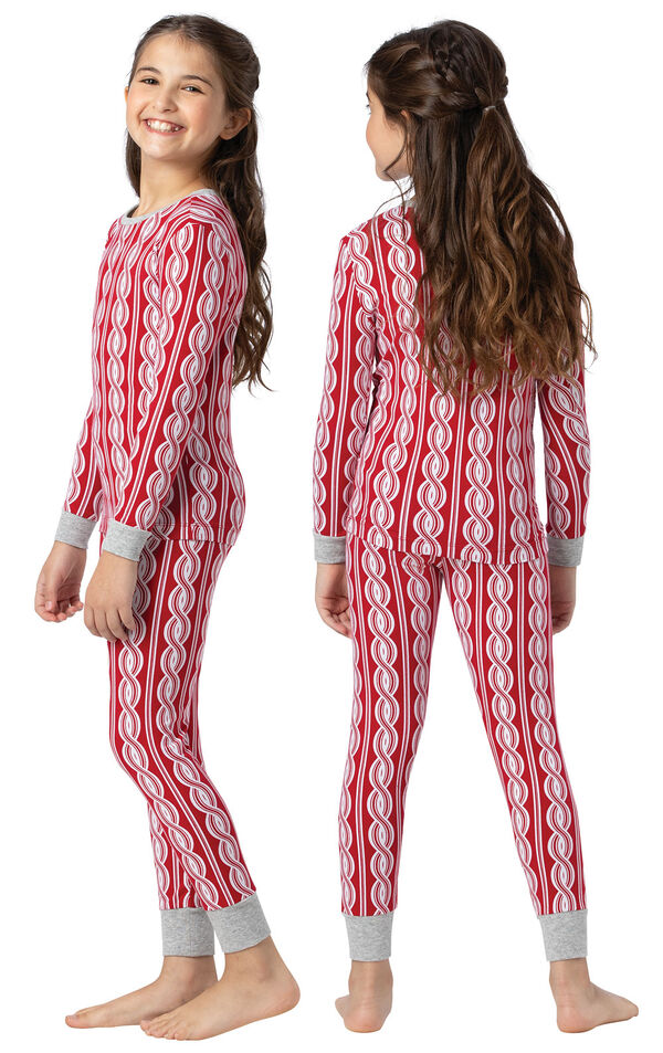 Model wearing Red and White Peppermint Twist PJ for Girls, facing away from the camera and then to the side image number 1