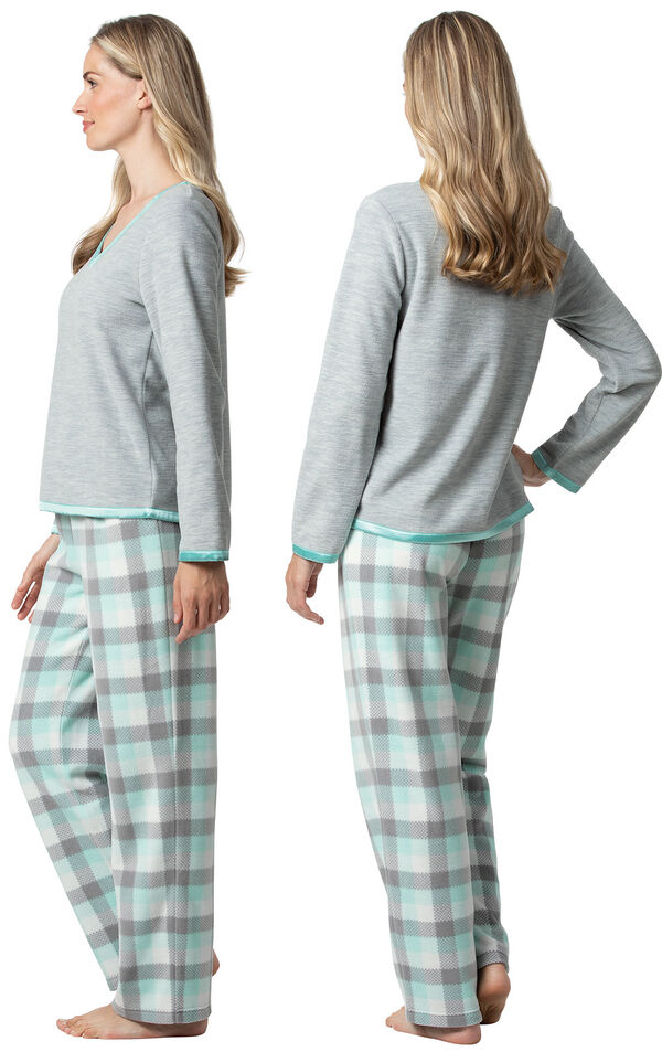 Model wearing Aqua Plaid Fleece PJ for Women, facing away from the camera and then to the side image number 1