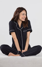 Model sitting cross-legged wearing Black Solid Short Sleeve Boyfriend PJ for Women image number 2
