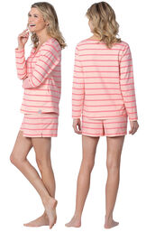 Model wearing Pink Margaritaville Long Sleeve Striped Short Set for Women, facing away from the camera and then to the side image number 1