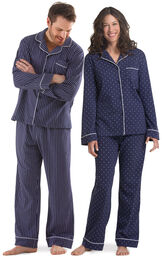 Models wearing Navy Blue and White Dots and Stripes Pajamas for Him and Her image number 0