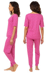 Model wearing Fuchsia Flower Print Jogger PJ for Women, facing away from the camera and then to the side image number 1
