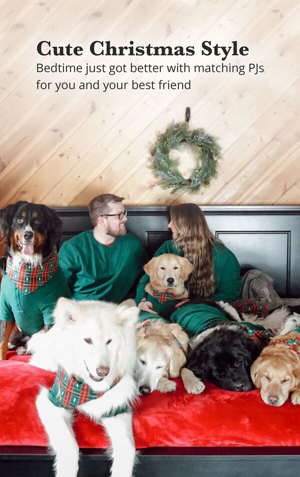 Owenrs and dogs sitting on bed wearing matching Christmas Tree Plaid pajamas with the following copy: Cute Christmas Style - Bedtime just got better with matching PJs for you and your best friend image number 1