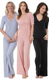 Models wearing Naturally Nude Pajamas - Solid Black, Naturally Nude Pajamas - Pink and Naturally Nude Pajamas - Blue.
