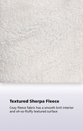 Close-up of the textured sherpa fleece with the following copy: Cozy fleece fabric has a smooth knit interior and oh-so-fluffy textured surface image number 4