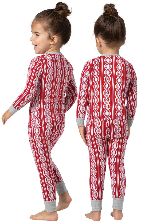 Model wearing Red and White Peppermint Twist PJ for Toddlers, facing away from the camera and then to the side image number 1