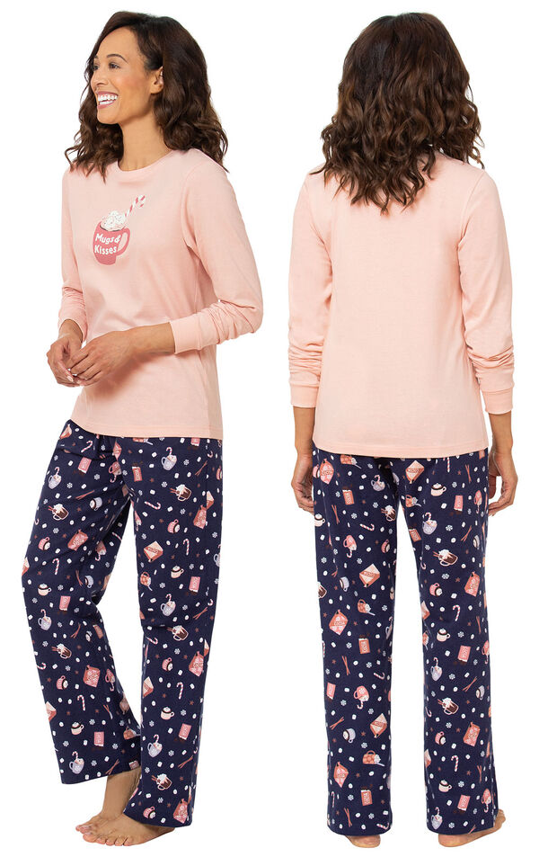 Model wearing Pink and Navy Blue Mugs & Kisses Pajamas, facing away from the camera and then facing to the side image number 1