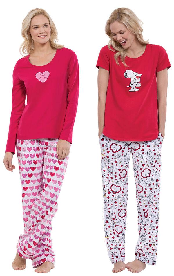 Models wearing Be Mine Pajamas and Snoopy's Valentine Pajamas. image number 0