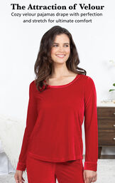 Model wearing Velour Long-Sleeve Pajamas - Ruby by bed with the following copy: The Attraction of Velour. Cozy velour pajamas drape with perfection and stretch for ultimate comfort image number 2