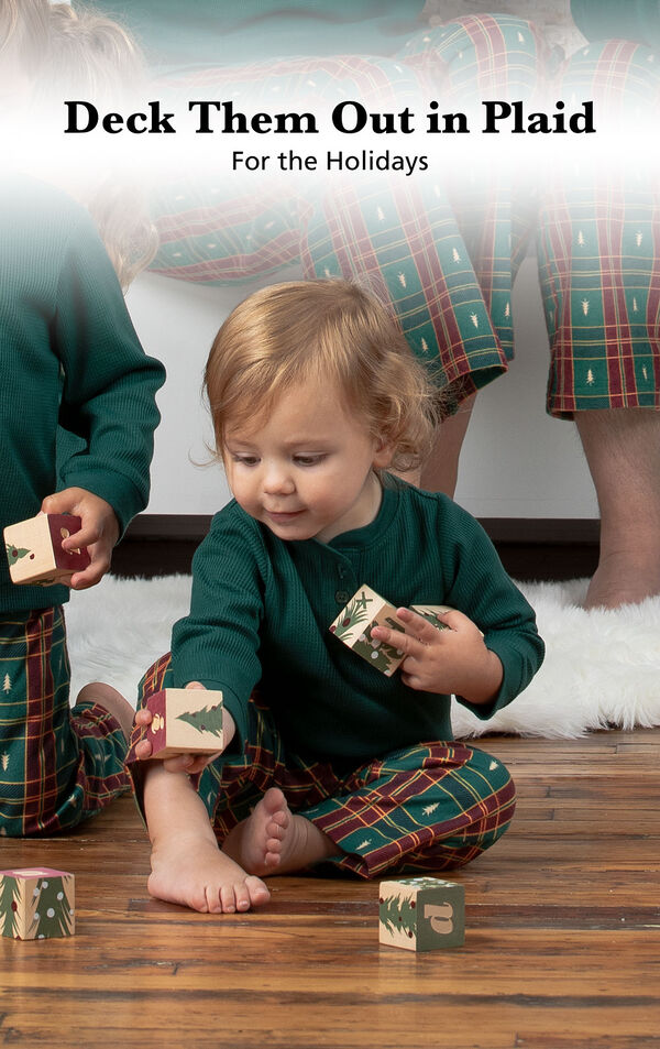 Infant playing with blocks wearing Red and Green Christmas Tree Plaid Infant Pajamas image number 2