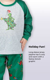 Close-up of Dr. Seuss' The Grinch PJ Long-Sleeve Top with the following copy: Holiday fun! Long-sleeve jersey pajama top is cozy and warm with a festive Grinch graphic. image number 2