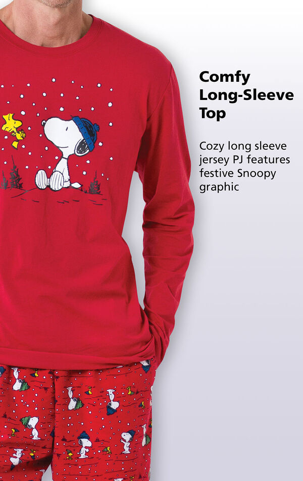 Close-up of the Red graphic top of Snoopy Men's PJs with the following copy: Comfy Long-sleeve top - cozy long sleeve jersey PJ features a festive Snoopy graphic image number 2