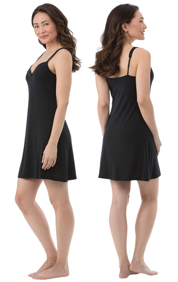 Model wearing Black Stretch Knit Chemise for Women, facing away from the camera and then facing to the side image number 1