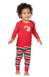 Model wearing Red and Green Christmas Stripe PJ for Infants