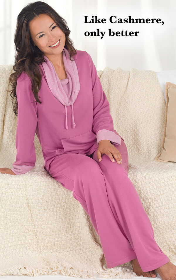 Model wearing Raspberry World's Softest Pajamas sitting on a couch with the following copy: Like cashmere, only better. image number 2