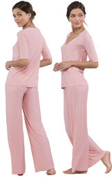 Model wearing Light Pink Stretch Knit Geo Print PJ for Women, facing away from the camera and then facing to the side image number 1