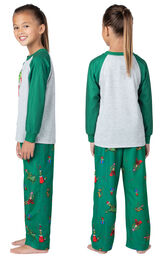 Model wearing Green and Gray Dr. Seuss' The Grinch™ Girls Pajamas, facing away from the camera and then facing to the side image number 1