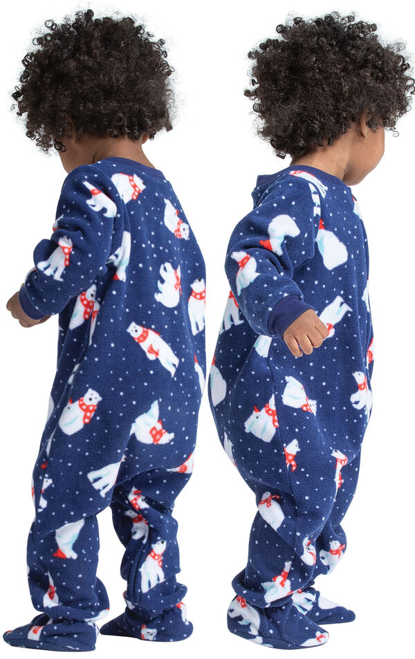 Model wearing Navy Polar Bear Fleece Onesie PJ for Infants, facing away from the camera and then facing to the side image number 1