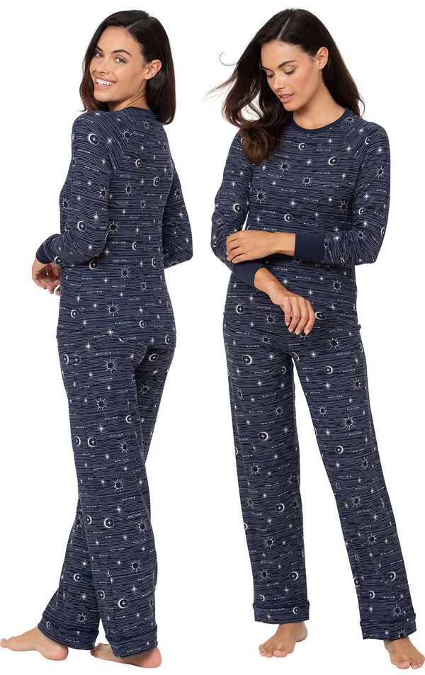 Model wearing Navy Blue Sun and Moon Print PJs for Women, facing away from the camera and then facing to the side image number 1