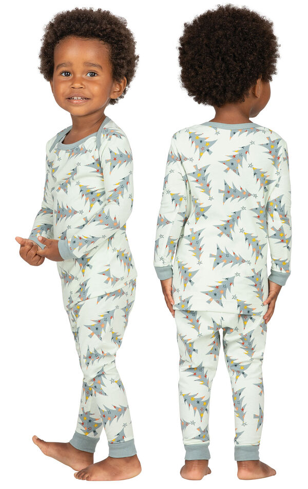 Model wearing Green Pine Tree PJ for Infants, facing away from the camera and then to the side image number 1