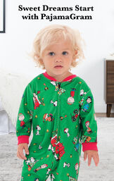 Infant wearing Charlie Brown Christmas Onesie Pajamas by bed with the following copy: Make it a Charlie Brown Christmas. image number 1