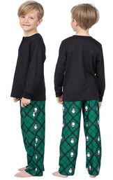Model wearing Black and Green Snowman Argyle Henley PJ for Kids, facing away from the camera and then to the side image number 1