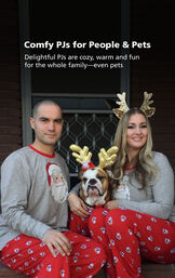 Photo of customers wearing matching Red and Gray St. Nick Pajamas, with the following copy: Comfy PJs for People and Pets - delightful PJs are cozy, warm and fun for the whole family- even pets image number 2