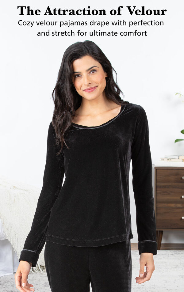 Model wearing Velour Long-Sleeve Pajamas - Black by bed with the following copy: The Attraction of Velour. Cozy velour pajamas drape with perfection and stretch for ultimate comfort image number 2