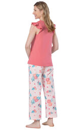 Model wearing Pink Margaritaville Capri PJ for Women, facing away from the camera image number 1