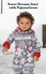 Infant wearing Nordic Fleece Hoodie-Footie by bed with the following copy: Sweet Dreams Start with PajamaGram. image number 1