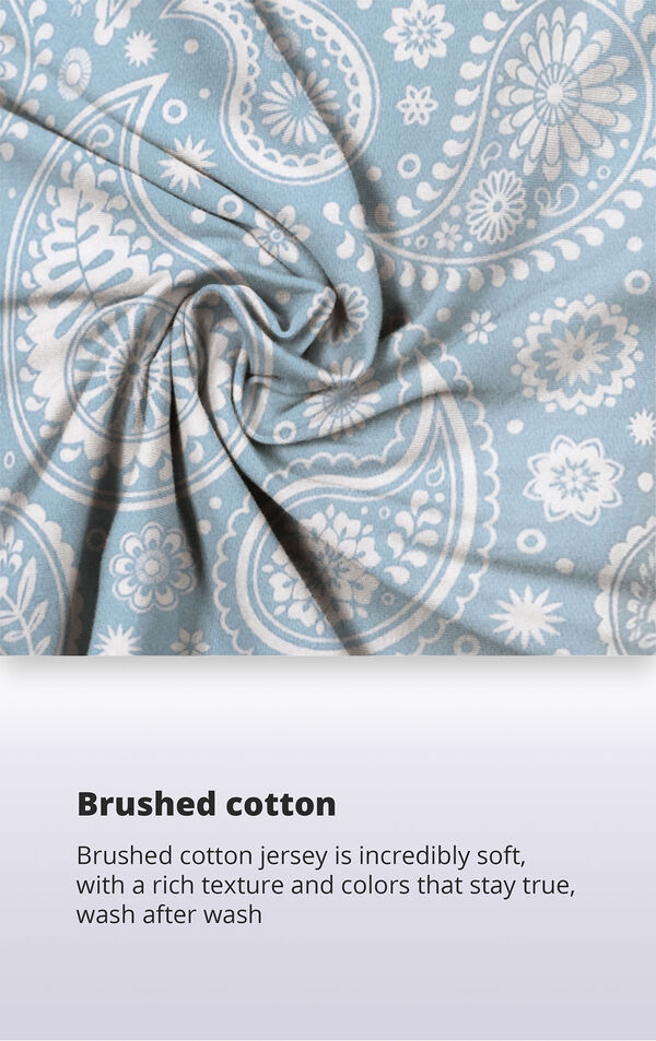 Blue and white paisley print fabric with the following copy: Brushed cotton jersey is supremely soft, with a rich texture and colors that stay true wash after wash image number 4
