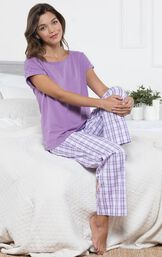 Model sitting on bed wearing Purple and White Perfectly Plaid Pajamas image number 1