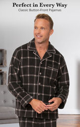 Model standing by couch wearing Men's Button Front Fleece Pajamas - Charcoal with the following copy: Perfect in Every Way Classic Button-Front Pajamas image number 2