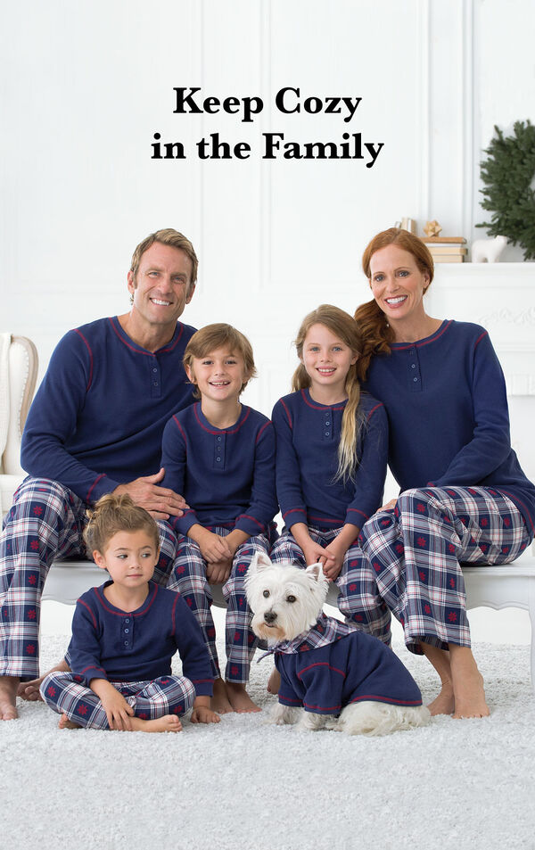 Parents and kids wearing Blue Snowfall Plaid Matching Family Pajamas with the following copy: Keep Cozy in the Family. image number 1