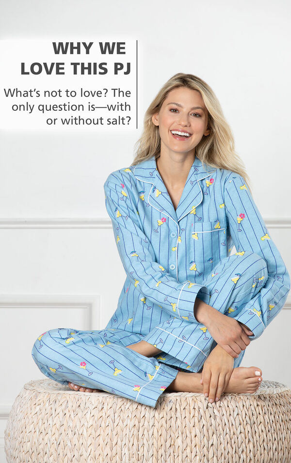 Model sitting on bed wearing Blue with Margarita Print Margaritaville Flannel Boyfriend Pajamas - Cocktail O'Clock and the following copy: The only question is - with or without salt? image number 2