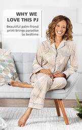 Model wearing Margaritaville Tan PJs with Palm Frond Print and Light Blue trim with the following copy - Why We Love this PJ - beautiful palm-frond print brings paradise to bedtime image number 2