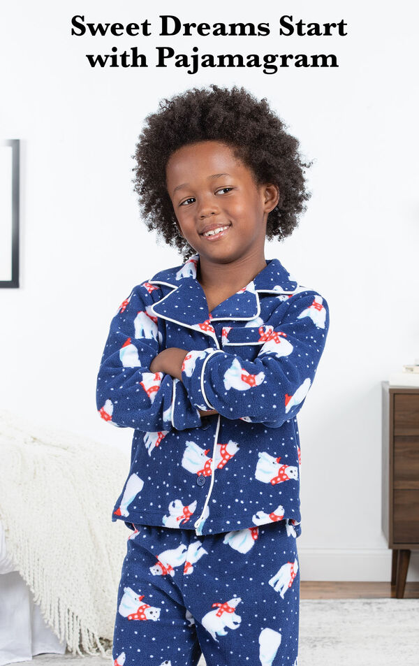 Boy wearing Polar Bear Fleece Boys Pajamas by bed with the following copy: Sweet Dreams Start with PajamaGram image number 2