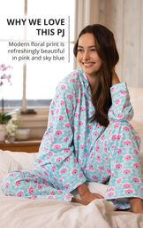 Model wearing Modern Floral Boyfriend Pajamas sitting on bed with the following copy: Modern floral print is refreshingly beautiful in pink and sky blue image number 2
