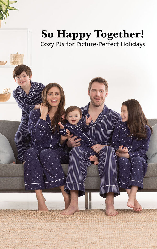 Parents and children wearing Navy Blue Dots-n-Stripes Matching Family Pajamas. Headline: So Happy Together! Cozy PJs for Picture-Perfect Holidays. image number 1