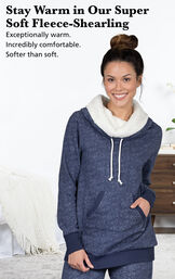 Model wearing Solstice Shearling Rollneck Pajamas by bed with the following copy: Stay warm in our Super-Soft Fleece-Shearling. Exceptionally warm, incredibly comfortable, softer than soft. image number 3