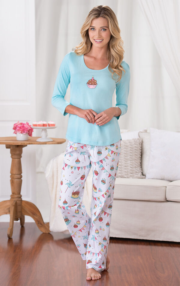 Model wearing Light Blue and White Happy Birthday Pajamas, standing by couch image number 1