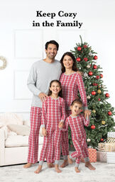 Family wearing matching Peppermint Twist PJs by the Christmas Tree for the Perfect Family Photo image number 1