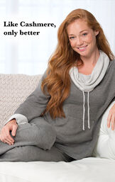 Model wearing Charcoal World's Softest Pajamas sitting on a couch image number 1