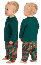 Model wearing Red and Green Christmas Tree Plaid Thermal Top PJ for Infants, facing away from the camera and then to the side image number 1
