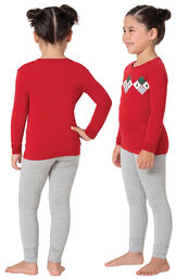 Model wearing Red and Gray Holiday Argyle Girl's Pajamas, facing away from the camera and then facing to the side image number 1
