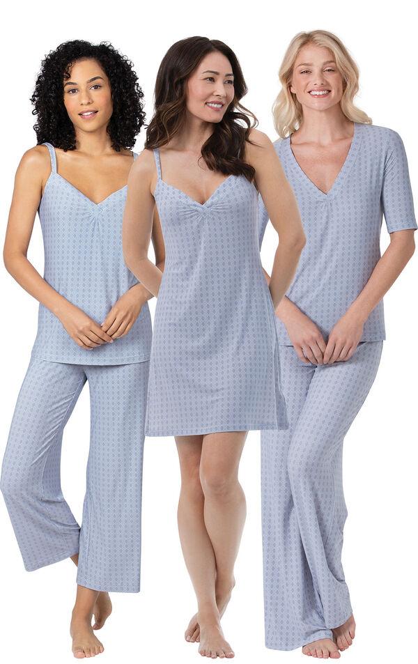Models wearing Naturally Nude Capri Pajamas - Blue, Naturally Nude Pajamas - Blue and Naturally Nude Chemise - Blue. image number 0