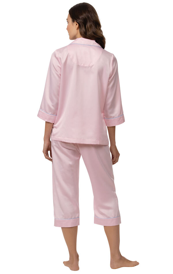 Model wearing Light Pink Satin Button-Front Capri PJ with Blue Trim for Women facing away from the camera image number 1