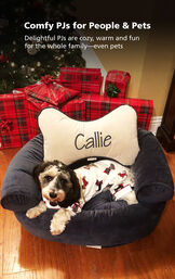 Dog sitting by Christmas Tree wearing Cream Holiday Dog Print PJs with the following copy: Comfy PJs for People and Pets - delightful PJs are cozy, warm and fun for the whole family- even pets image number 2