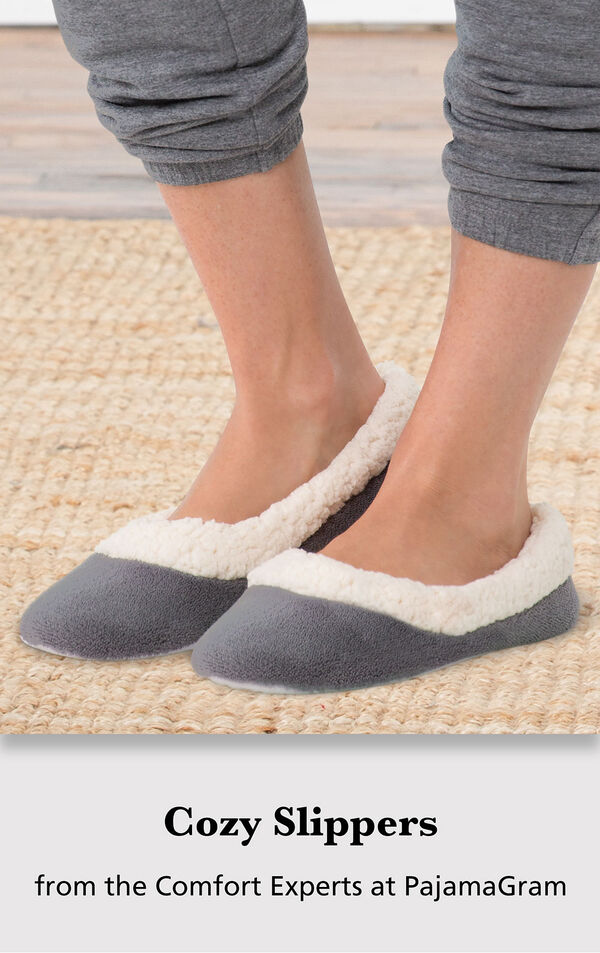 Model wearing Charcoal World's Softest Slippers standing on a rug with the following copy: Cozy Slippers from the Comfort Experts at PajamaGram image number 2