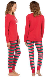 Model wearing Red and Green Christmas Stripe PJ for Women, facing away from the camera and then to the side image number 1
